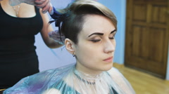 Stylist in a beauty studio does hair dye. She decided to cardinally change its Stock Footage