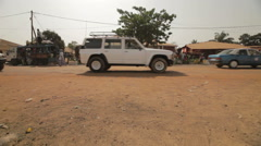 Cars crossing in Bissau Stock Footage