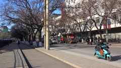 Road traffic at the Beiwei road (near Tianqiao Theater) at winter. Beijing - stock footage