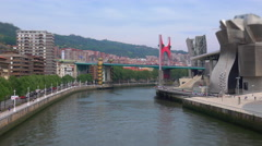 Wide tilit shift Left panning timelapse of Bilbao Guggenheim  Stock Footage