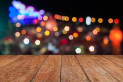 Perspective top wooden with abstract blurred lights Stock Photos