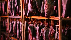 Dried meat hanging in the food factory Stock Footage