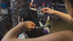 Beauty studio, for brunettes with long hair making process fire haircut Stock Footage