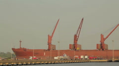 Red freighter loading Stock Footage