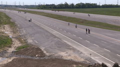 People walking biking an rollerblading on highway 407 Stock Footage