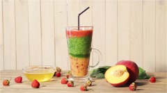 Tasty smoothies for breakfast with peach, mango, spinach, yogurt, strawberry Stock Footage