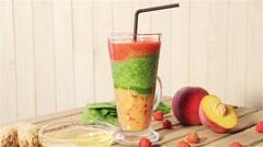 Tasty smoothies for breakfast with peach, mango, spinach, yogurt, strawberry Stock Footage
