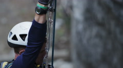 Rock Climber Rappelling Down Rock Wall Stock Footage
