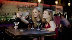 company of young people is chatting and clinking glasses in the bar - stock footage