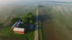 Scenic aerial view of rural Wisconsin on foggy spring morning - stock footage