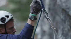 Rock Climber Face Abseiling Down Steep Rock Wall - stock footage