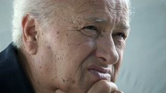 Sad and pensive old man closeup portrait Stock Footage