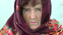 Depressed and sad old woman closeup portrait: lonely old woman with headscarf Stock Footage