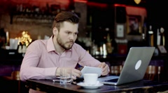 Young business man has turned upset working in a bar Stock Footage