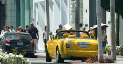 Luxury cars traffic on Rodeo Drive n Beverly Hills, Los Angeles, California 4K Stock Footage
