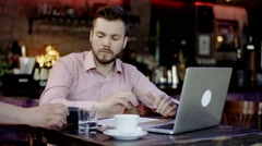 Young business man paying with a credit card in a bar Stock Footage