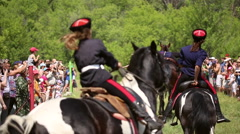 Girls don Cossacks riding on horses Stock Footage