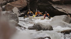 Slow Motion Whitewater Rafting Down Raging Rapids Stock Footage