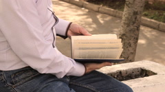 Man leafing through pages of a book Stock Footage