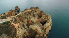 Cliffs in ocean near Ponte Piedade Lagos Portugal Stock Footage