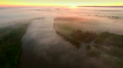 Mystical foggy country landscape with river, farms and homes - stock footage