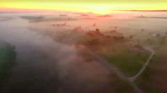 Mystical foggy country landscape with river, farms and homes Stock Footage