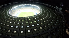 Impressive construction of sports arena with football field, modern architecture Stock Footage