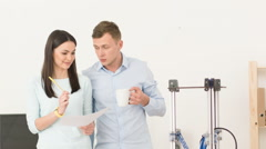 Pleasant colleagues standing in the office Stock Footage
