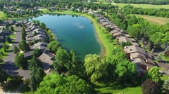 Lakeside suburb with many luxury homes lining it's shores - stock footage