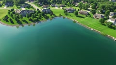 Lakeside suburb with many luxury homes lining it's shores Stock Footage