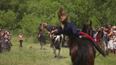 Riders riding on horses, they show acrobatics Stock Footage