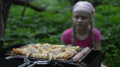 Girl in the Forest Sitting by the Brazier and Waits - stock footage