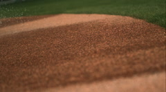 Water Spray Falling on the Dirt at a Baseball Field in Slow Motion. - stock footage
