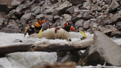 Whitewater Rafting Team Navigating Torrential Rapids In Slow Motion - stock footage