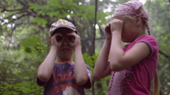 Boy and Girl Watching With Binoculars in an Improvised Stock Footage