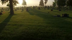 Cemetery on foggy morning, spectacular low aerial flyover Stock Footage