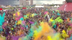 Aerial Flight Above Dancing People Crowd On Holi Festival Of Colors - stock footage