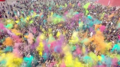 Aerial Flight Above Dancing People Crowd On Holi Festival Of Colors Stock Footage