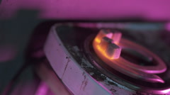 Coals for hookah light up on stove Stock Footage
