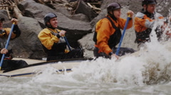 Huge Splashing In Whitewater Rapids As Boat And Crew Navigate In Slow Motion Stock Footage