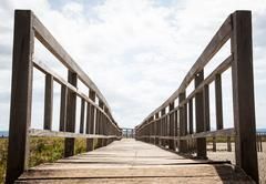 closeup wooden railing bridge - stock photo