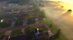 Beautiful neighborhood under spectacular foggy sunrise Stock Footage