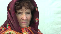 Peaceful old woman with a headscarf: tranquil old woman closeup portrait Stock Footage