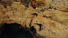 Cliffs in ocean near Ponte Piedade Lighthouse Lagos Portugal aerial view Stock Footage