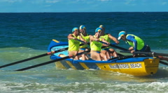 Close up of a surf boat racing on the sunshine coast of australia Stock Footage