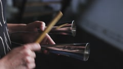 Playing a musical instrument agogo Stock Footage