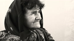 black and white portrait of an old wrinkled woman looking at the camera - stock footage