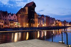 The Crane and Old Town of Gdansk at Dusk - stock photo
