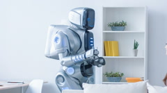 Pleasant robot giving glass of water to a woman Stock Footage
