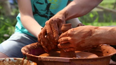 Potter makes pottery clay on a Potter's wheel Stock Footage